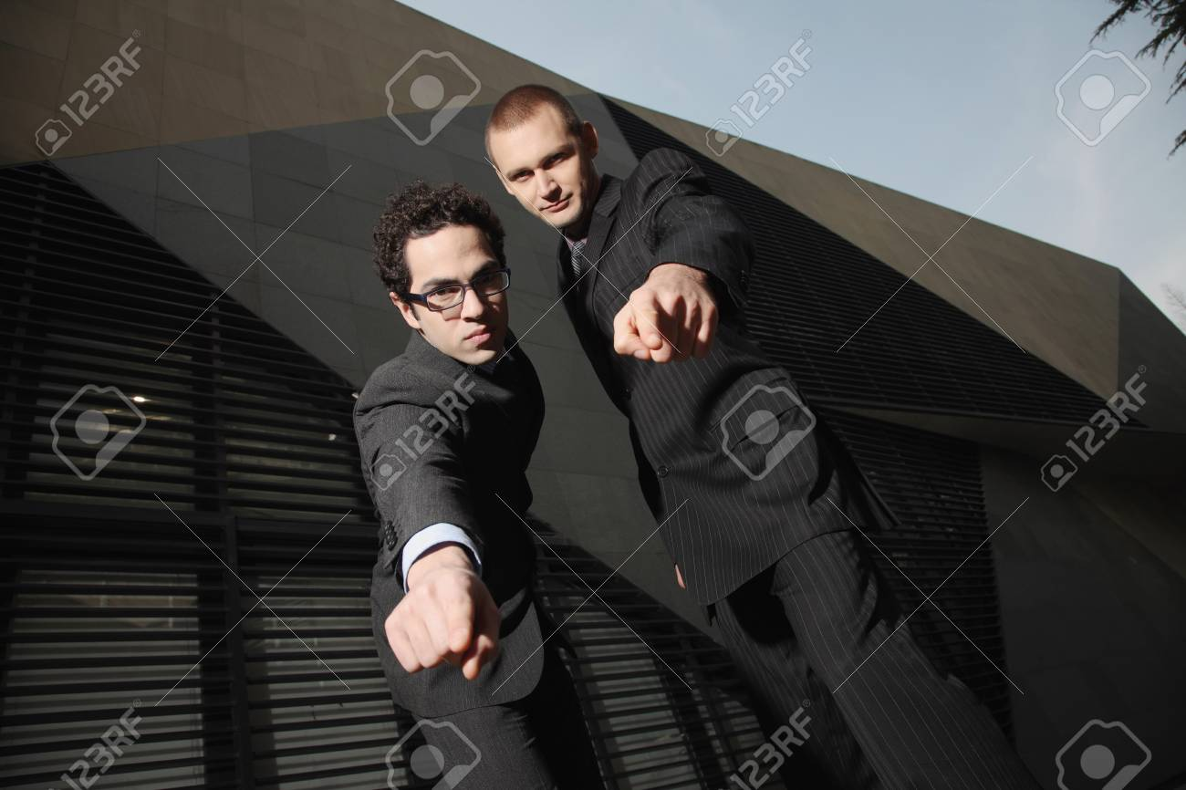 Businessmen pointing at the camera Stock Photo - 6990743