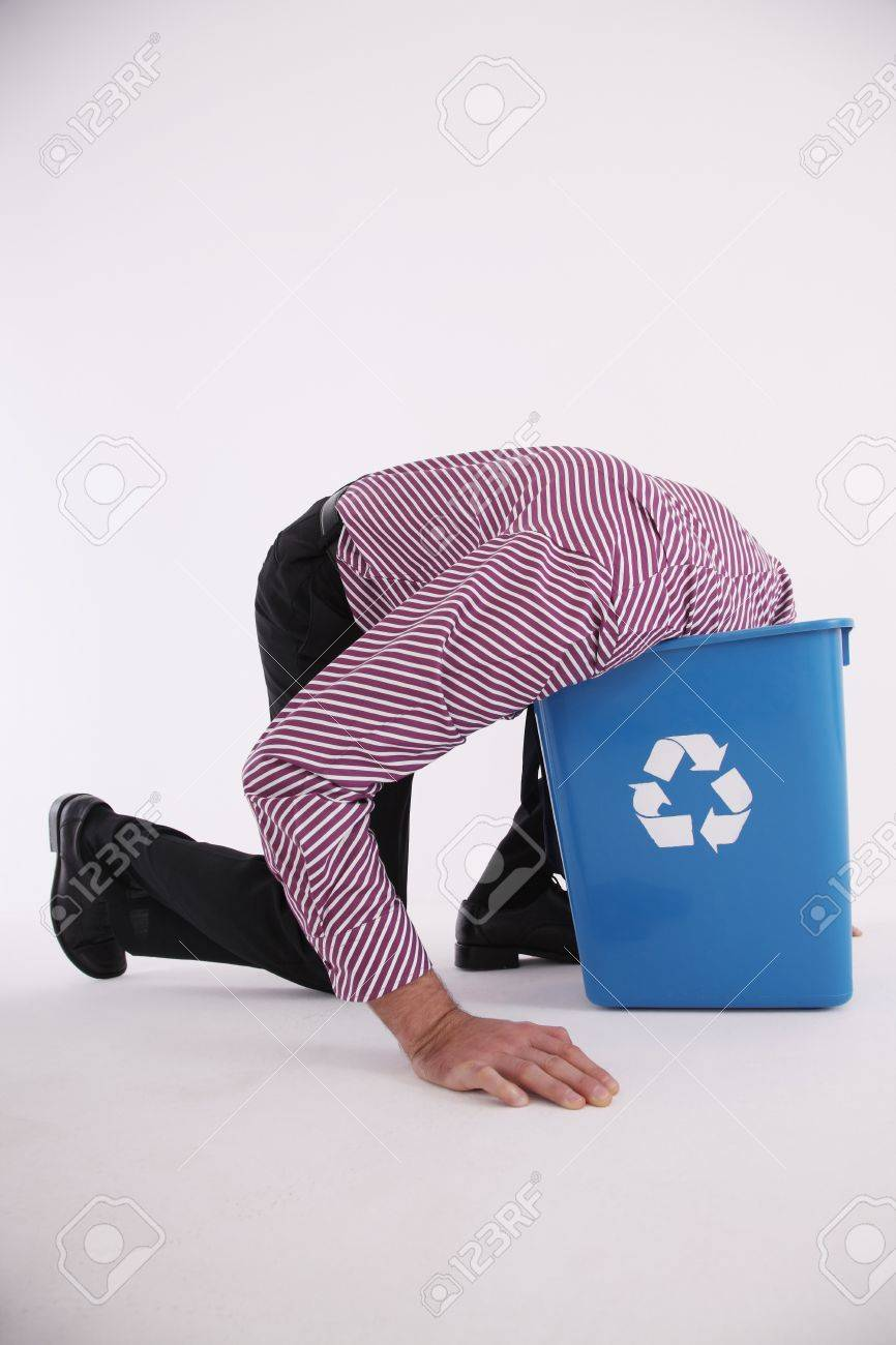 Businessman putting his head into the recycling bin Stock Photo - 6990751
