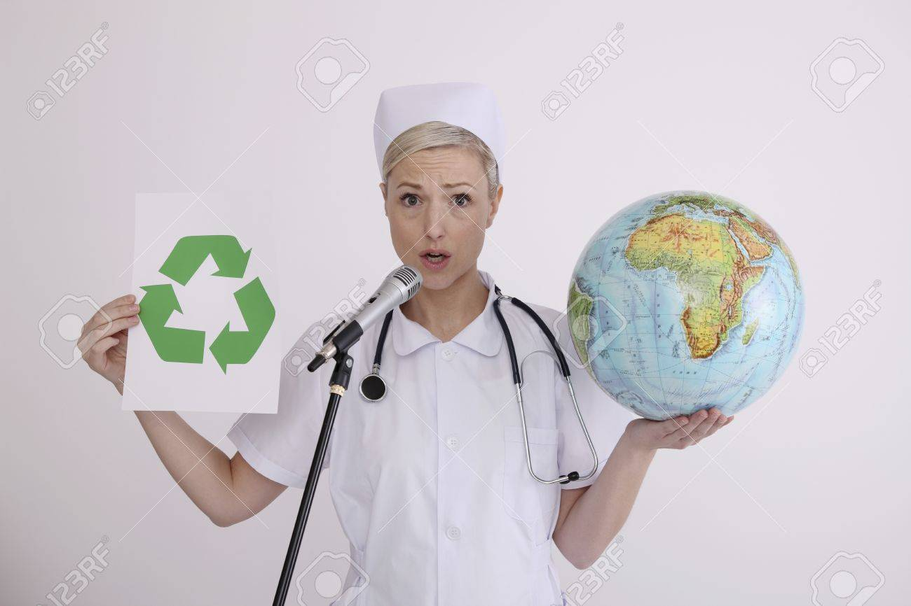 Nurse holding globe and recycling symbol while talking into microphone Stock Photo - 6990785