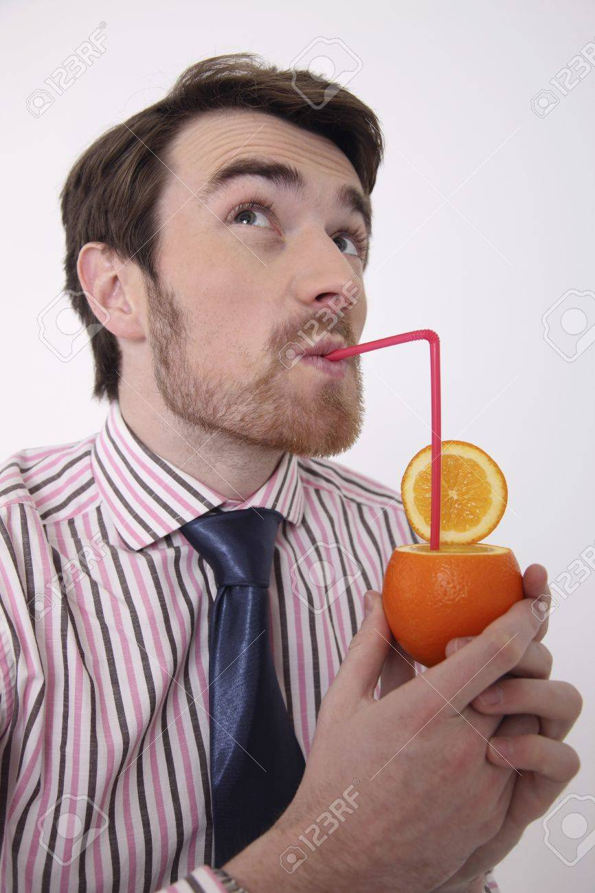 Man drinking fresh orange juice Stock Photo - 6990808