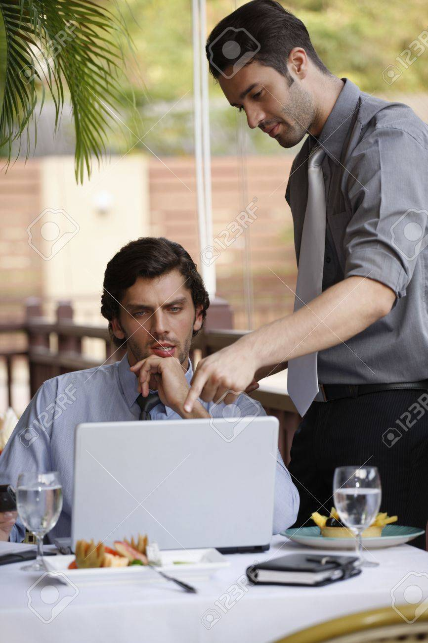 Businessmen discussing work over lunch at restaurant Stock Photo - 6925029
