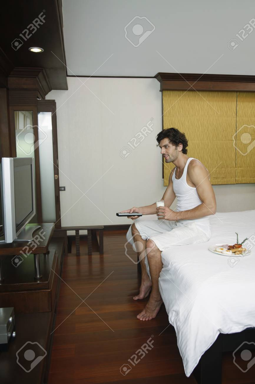 Man having breakfast while watching television Stock Photo - 6974169