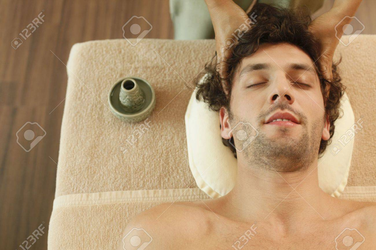 Massage therapist massaging man's head Stock Photo - 6974281
