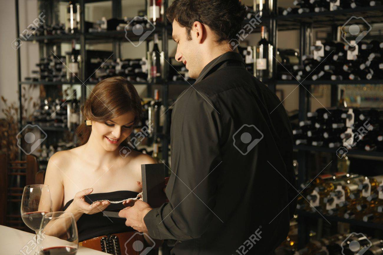 Man giving woman a diamond necklace Stock Photo - 7077061