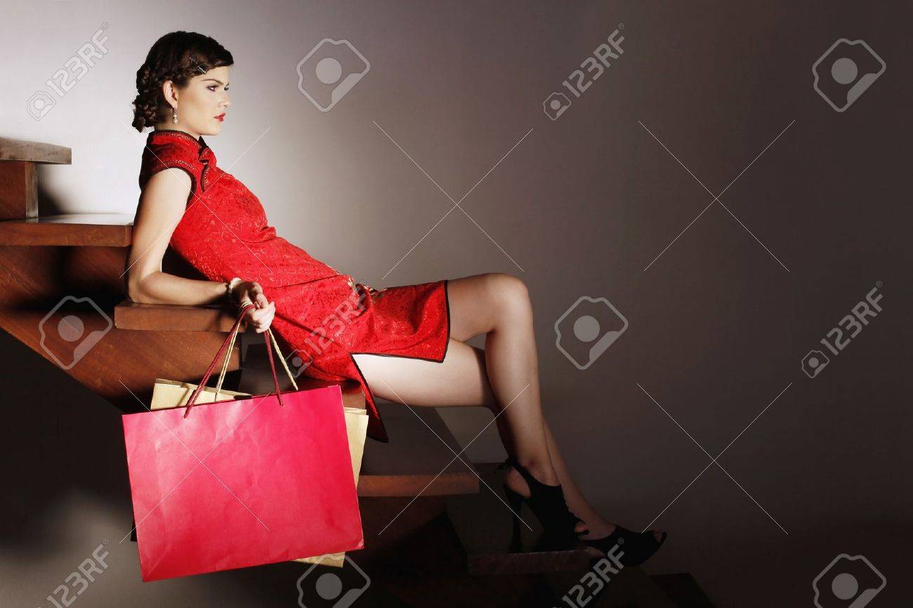Woman sitting on stairs carrying shopping bags Stock Photo - 7131699