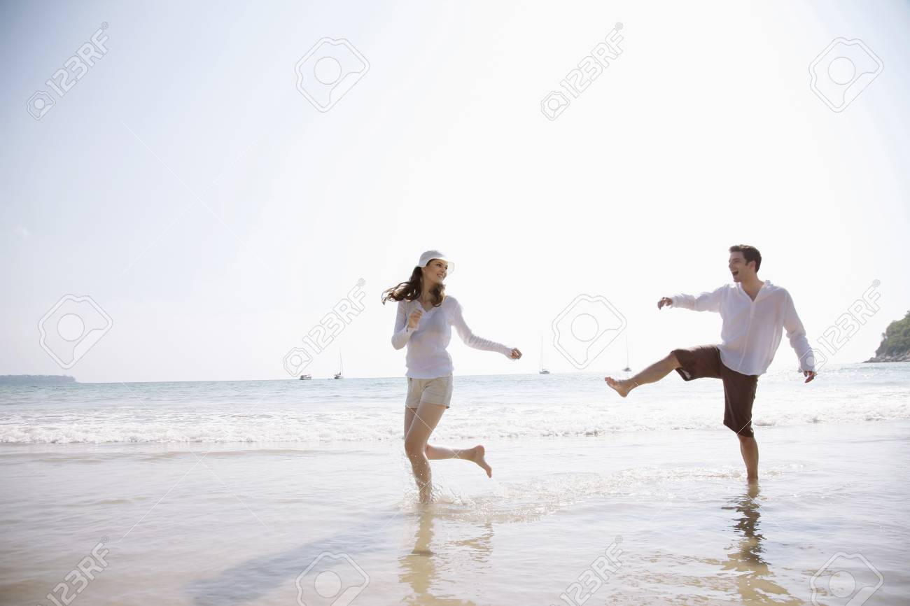 Man and woman playing on beach Stock Photo - 7355906