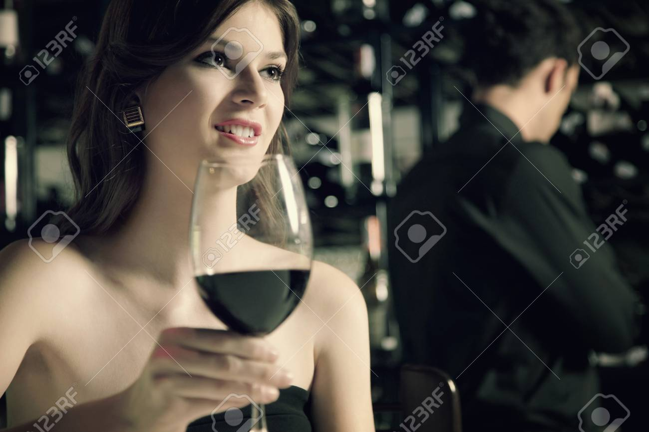 Woman with a glass of red wine Stock Photo - 7360453