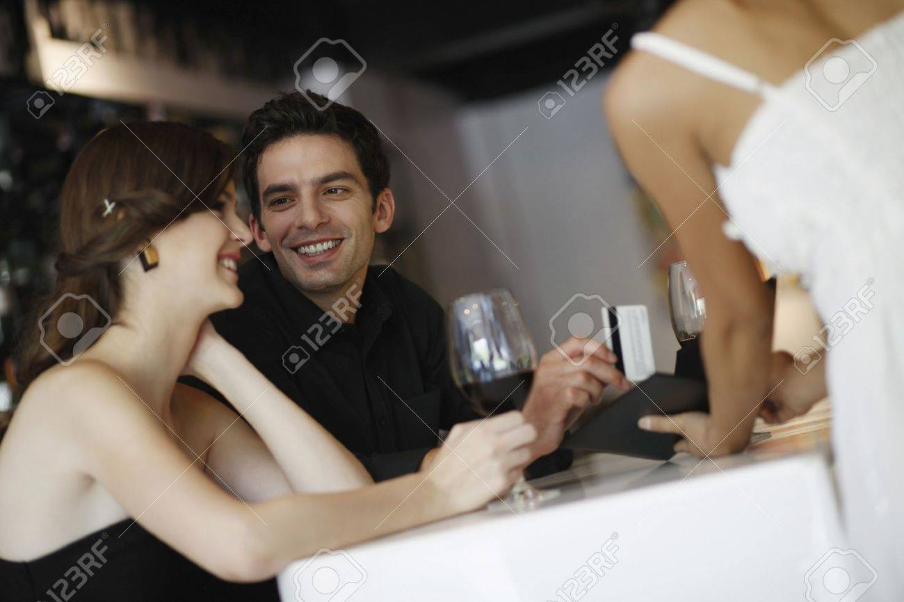 Man paying the bill with credit card Stock Photo - 7359138