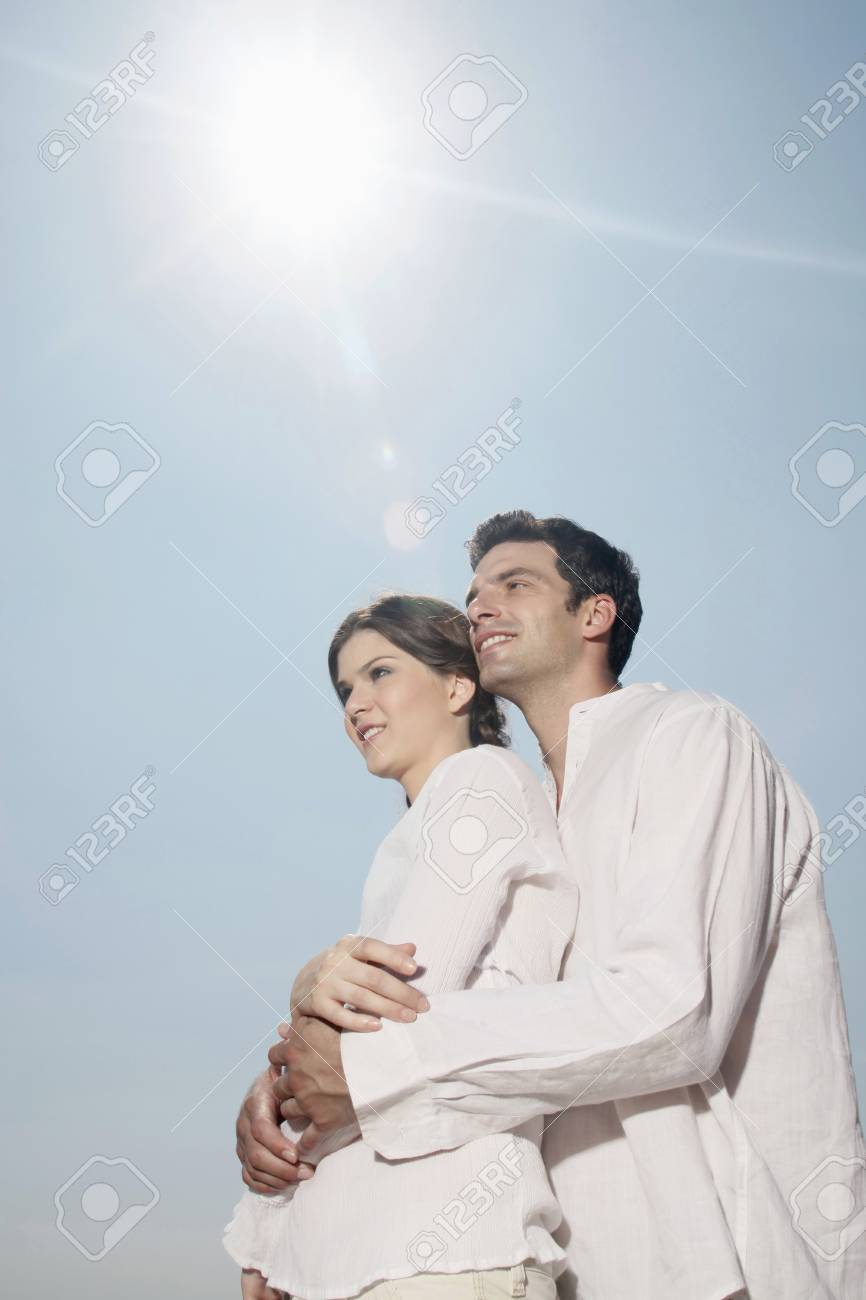 Man and woman embracing on the beach Stock Photo - 7359254