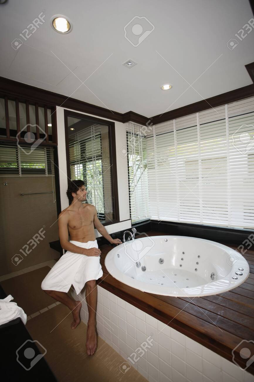 Man filling water into hot tub Stock Photo - 7360798