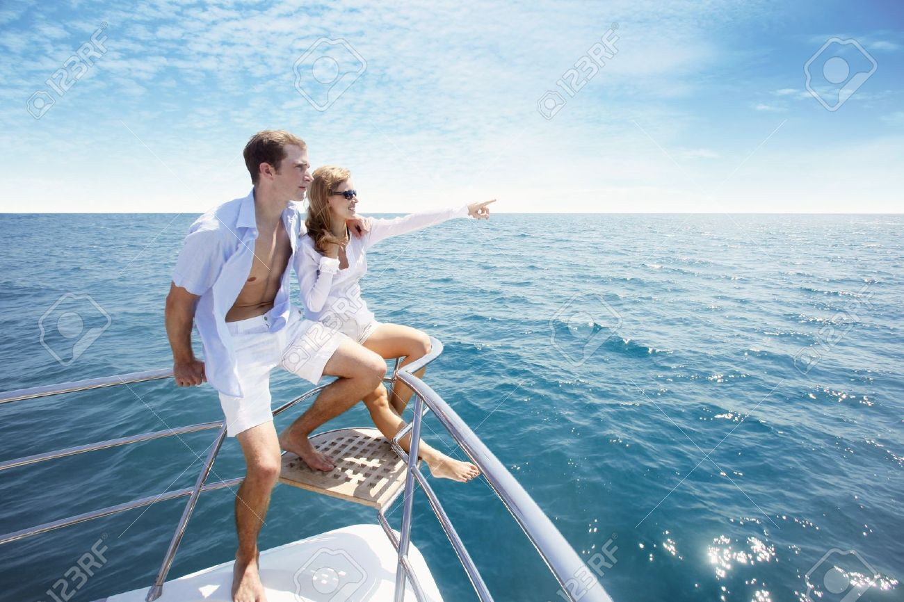 Couple relaxing at the tip of the yacht Stock Photo - 7362823