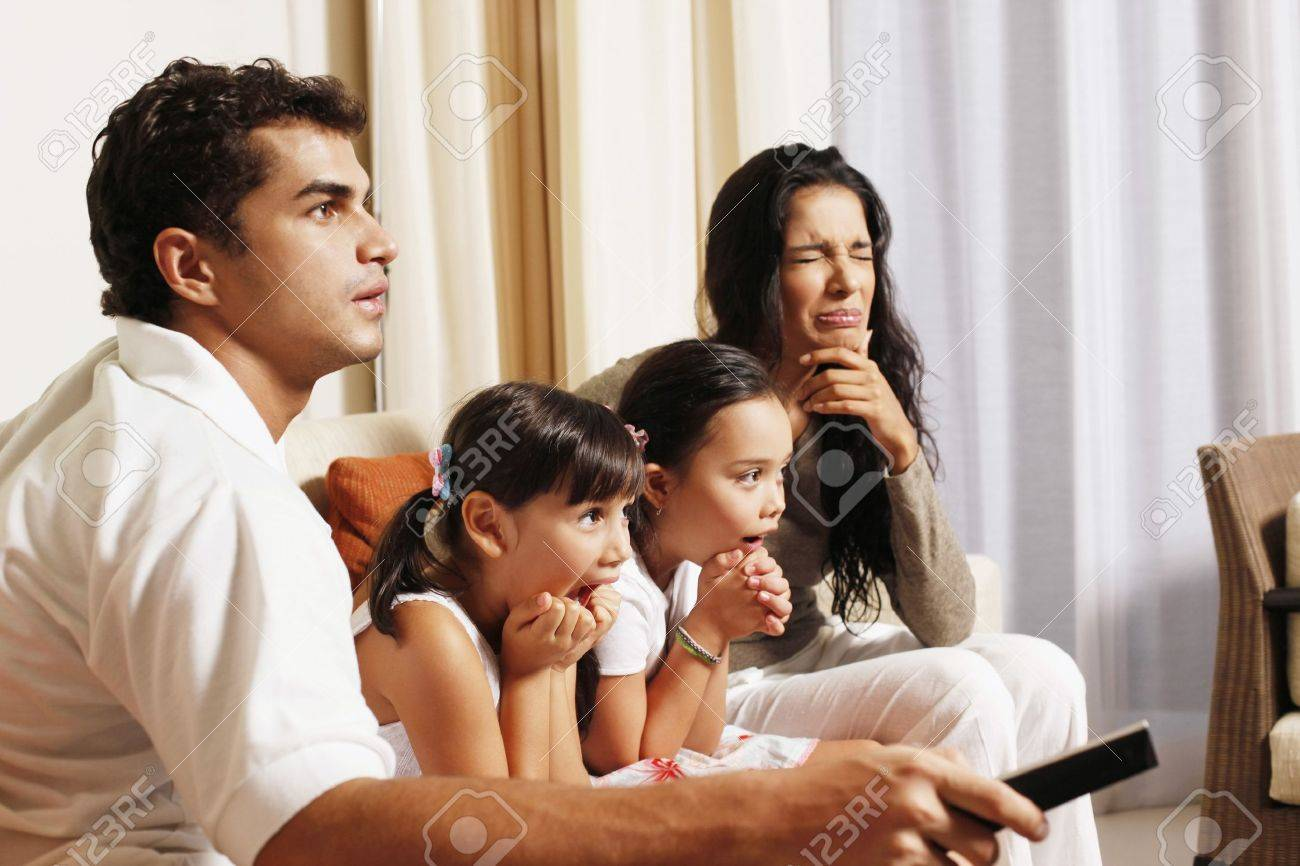 Family watching tv together Stock Photo - 7362008
