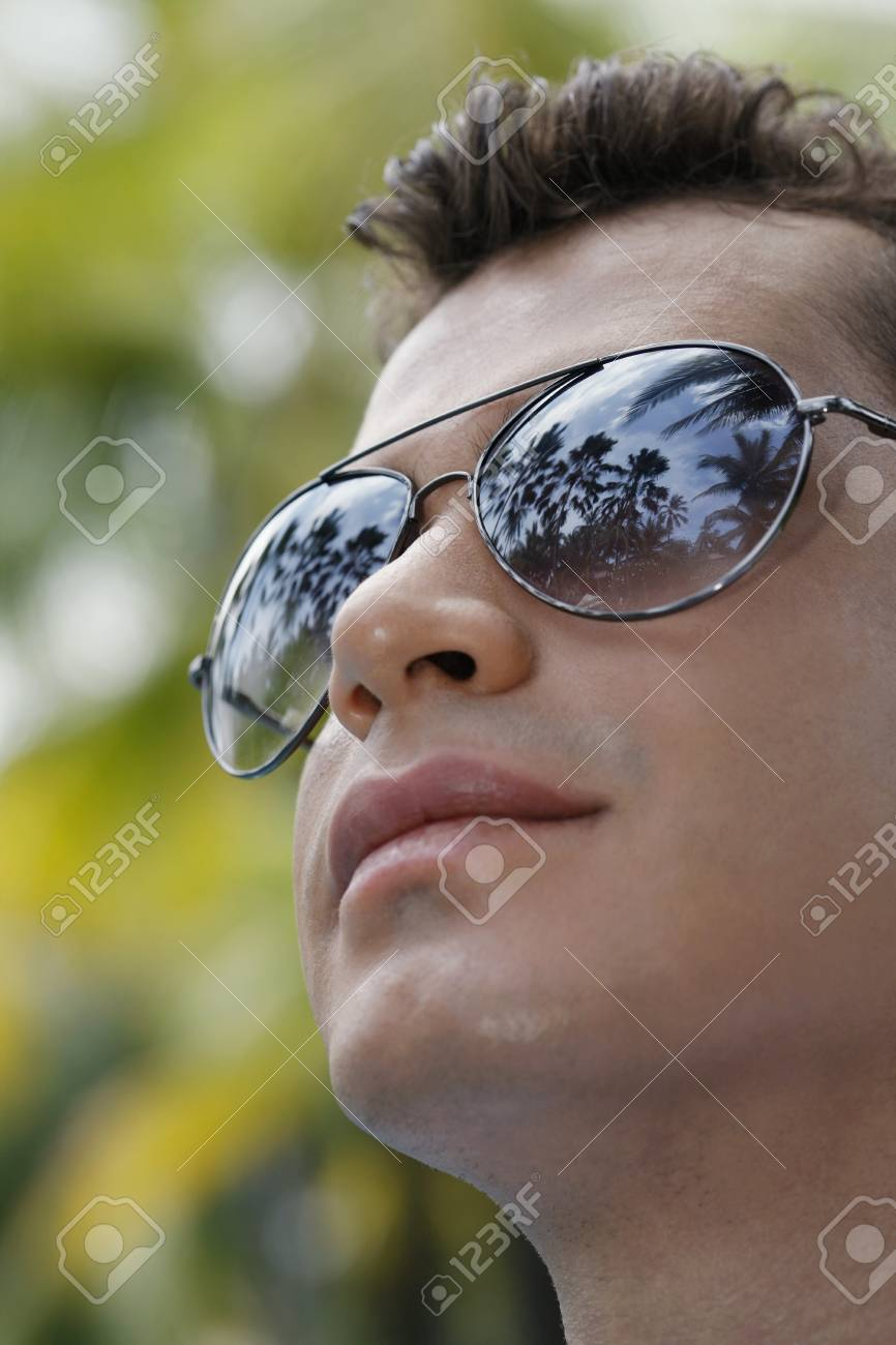 Man with sunglasses looking up Stock Photo - 7362175