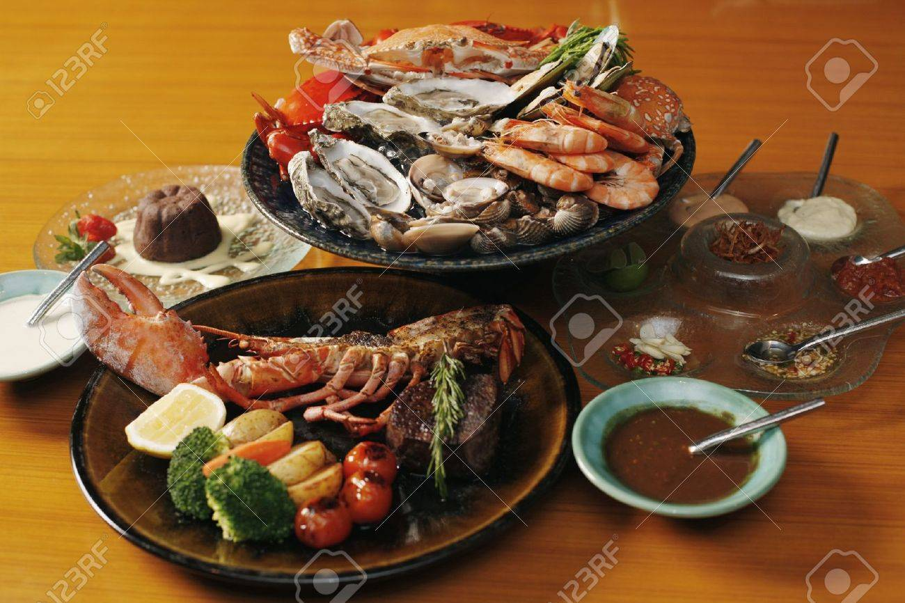 Seafood platter, lobster and chocolate cake Stock Photo - 7362615