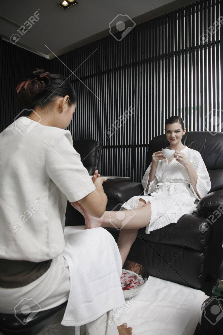 Spa attendant massaging a woman's foot Stock Photo - 7446632