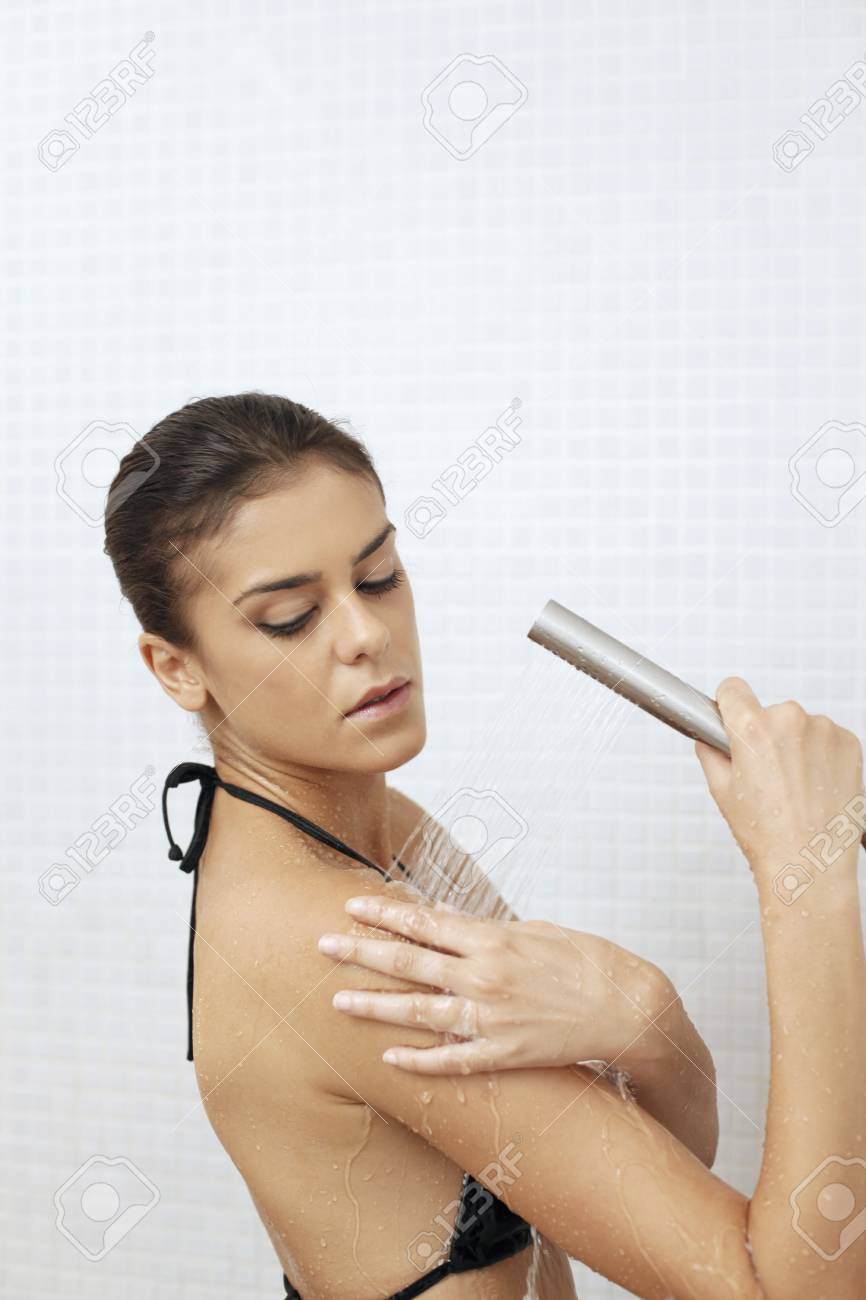 Woman showering in the bathroom Stock Photo - 7445925