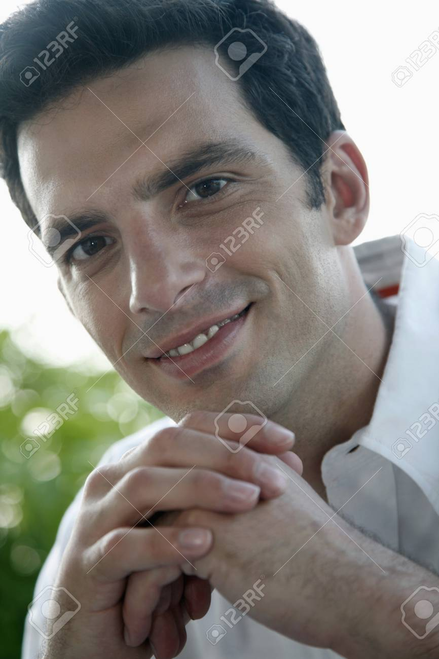 Man with hands on chin smiling Stock Photo - 7446329