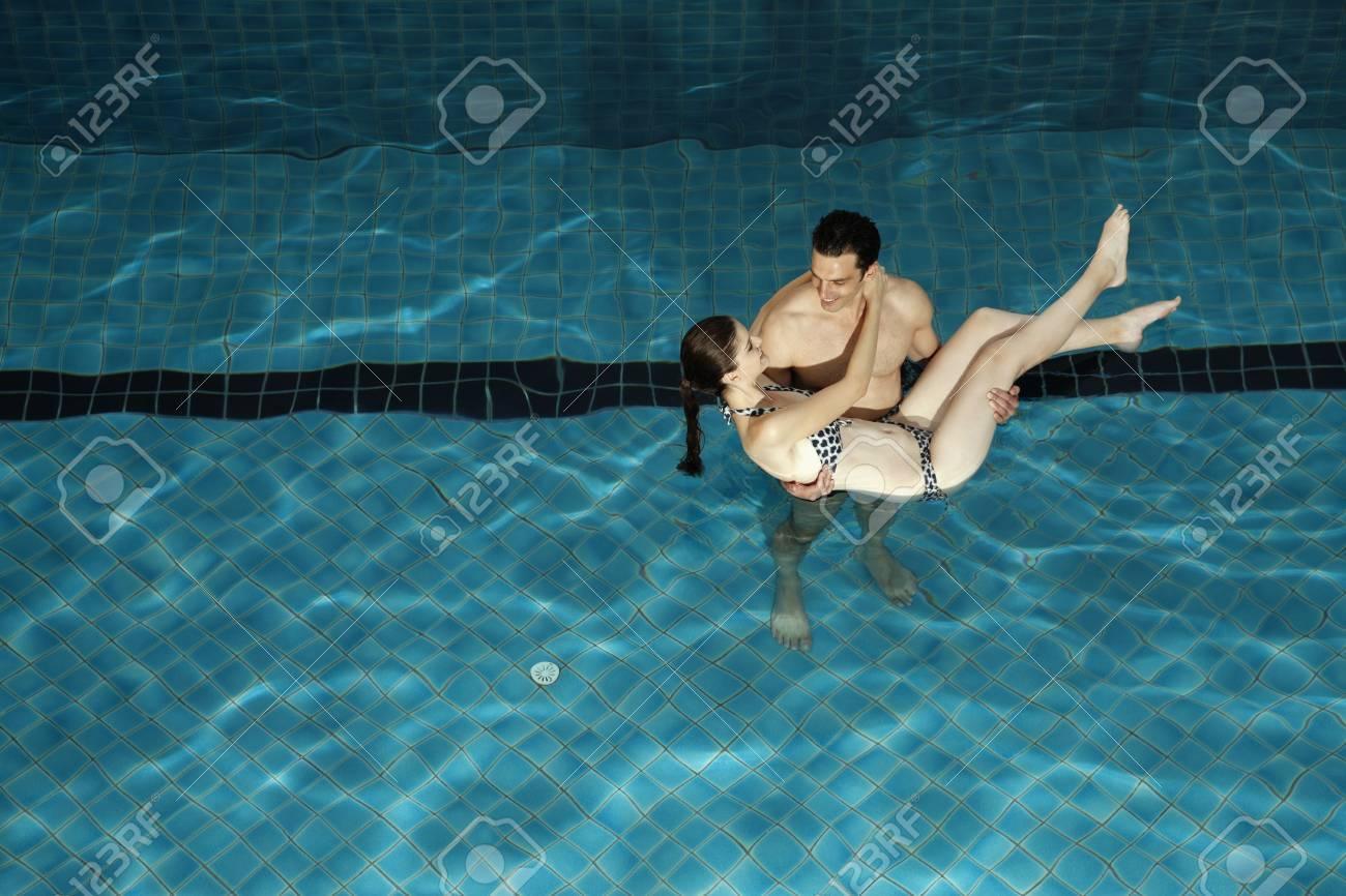 Man carrying woman in swimming pool Stock Photo - 7446938