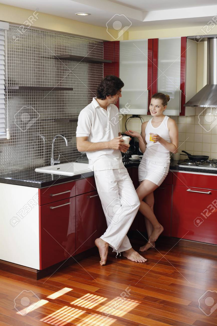 Couple enjoying beverages in the kitchen Stock Photo - 7446848