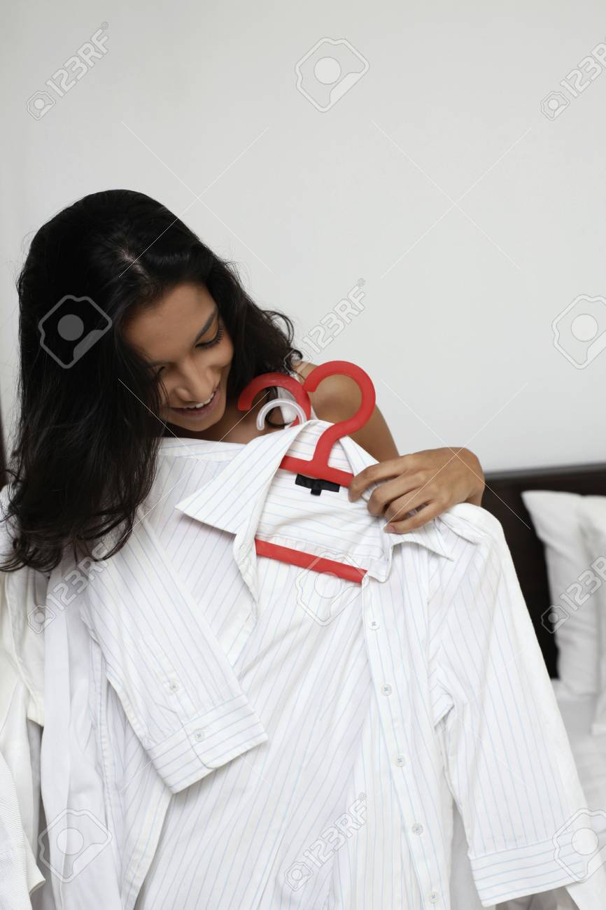 Woman holding clothes on hangers Stock Photo - 7446146