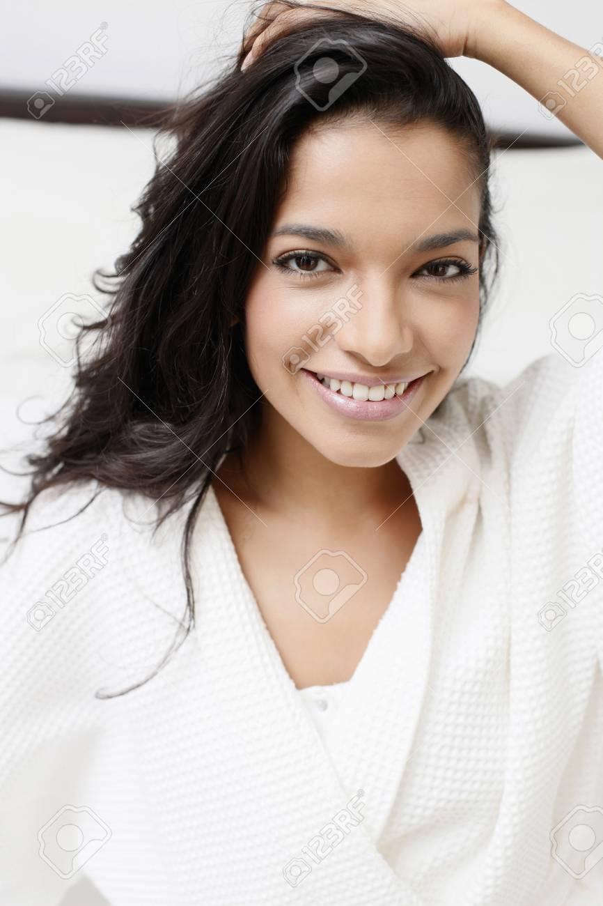 Woman in bathrobe sitting on the bed Stock Photo - 7446364