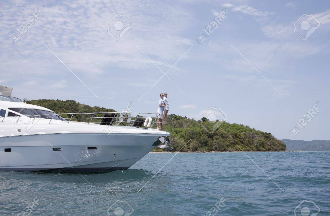 Couple standing at the tip of yacht Stock Photo - 7446681