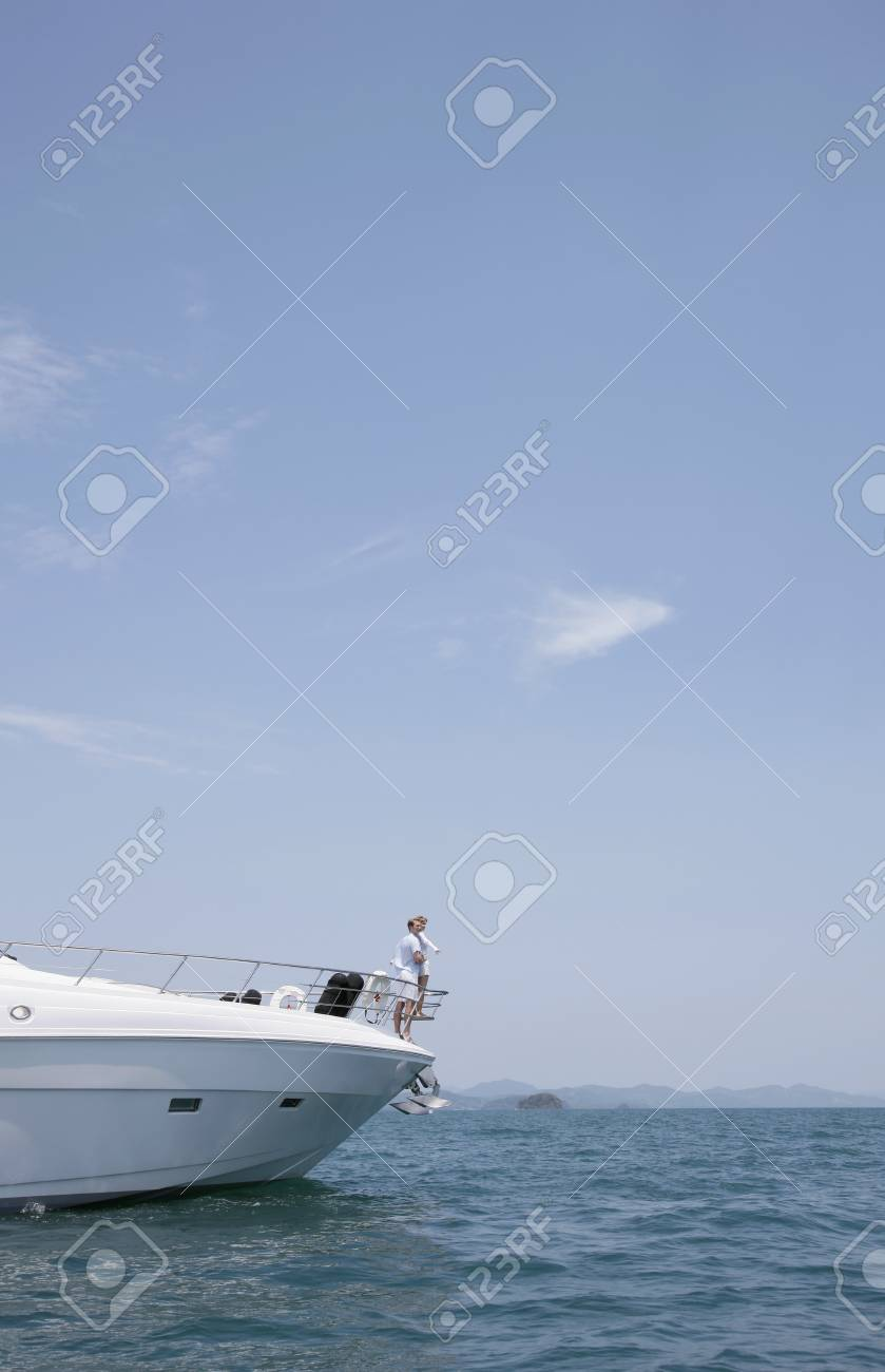 Couple standing at the tip of yacht Stock Photo - 7445829