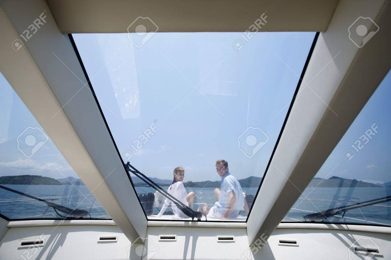 Couple sitting on yacht deck Stock Photo - 7445989