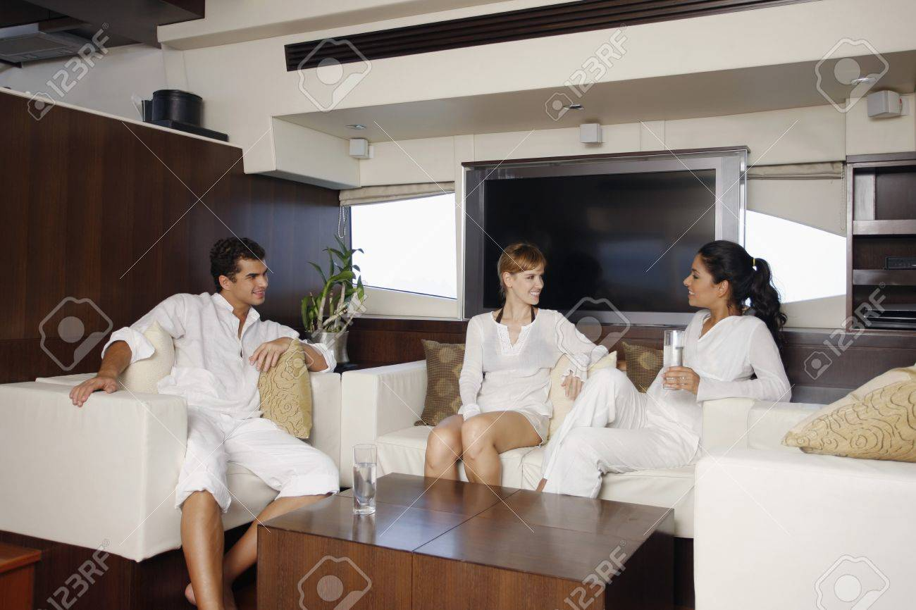 Man and women relaxing in yacht living room Stock Photo - 7478194