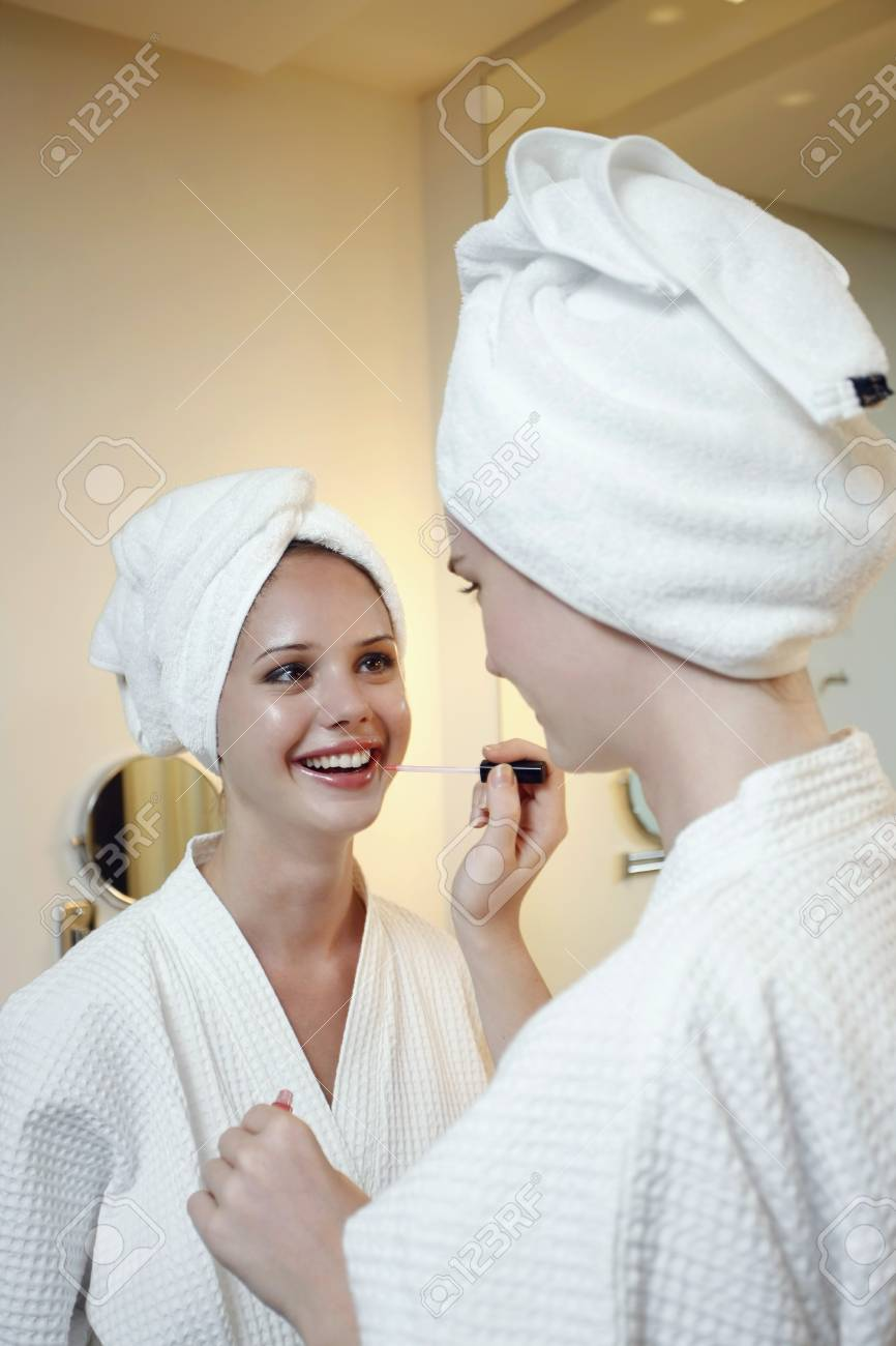Woman applying make-up for her friend Stock Photo - 7534475