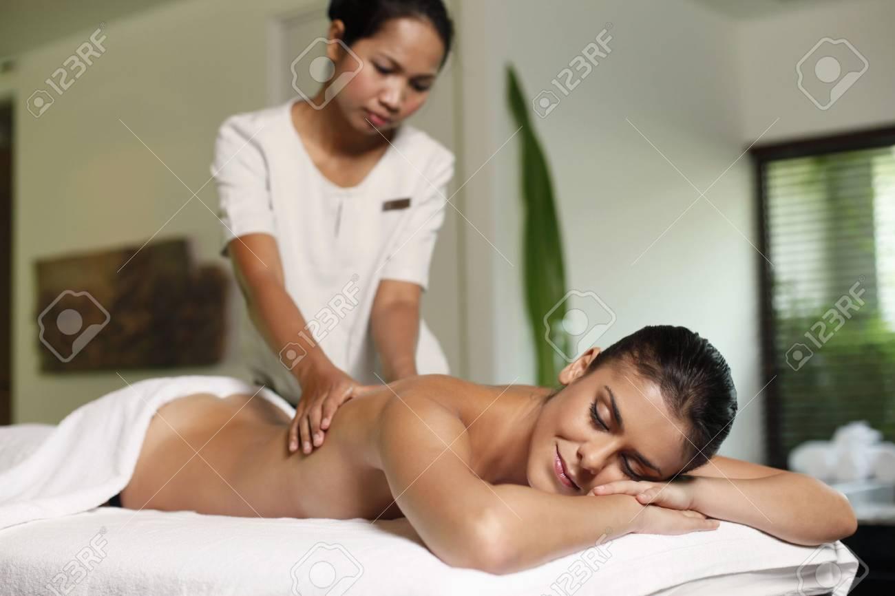 Woman receiving a back massage Stock Photo - 7534435