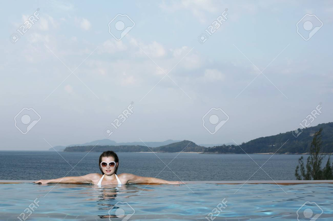 Woman with sunglasses in pool Stock Photo - 7594671