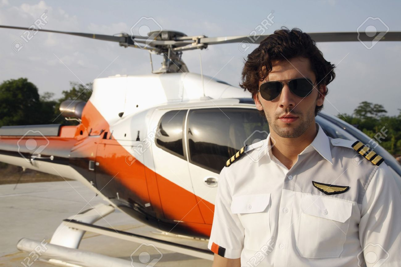 9581e7478f Pilot wearing sunglasses standing in front of helicopter Stock Photo -  7594968