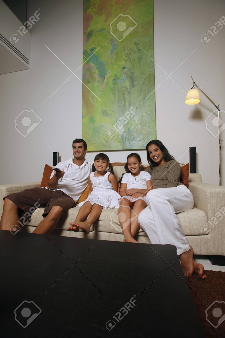 Family watching tv together Stock Photo - 7594817