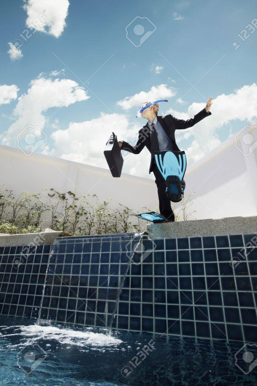 Businesswoman With Scuba Gear On Jumping Into Swimming Pool Stock ...