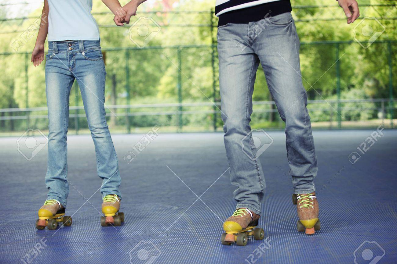 Man and woman holding hands while roller skating Stock Photo - 8149201