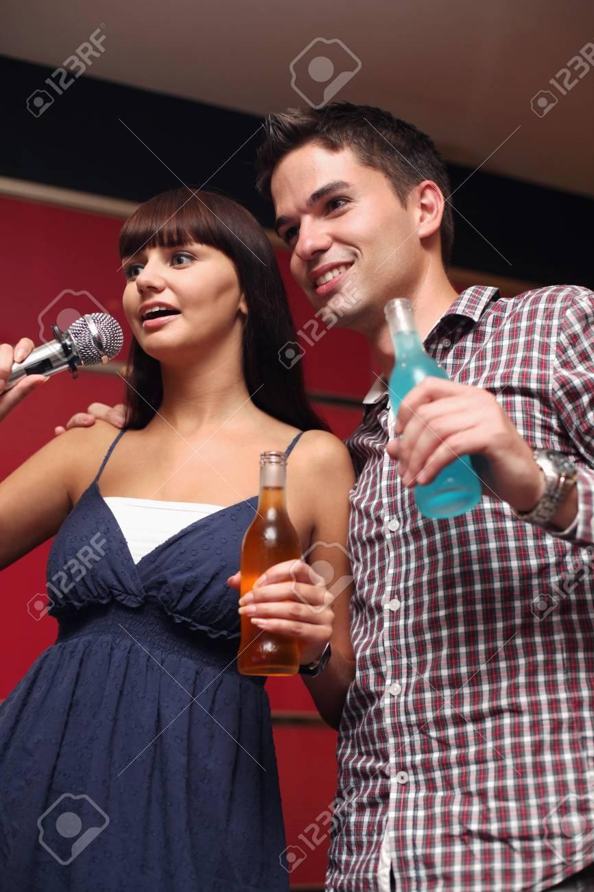 Man and woman at karaoke bar Stock Photo - 8149299