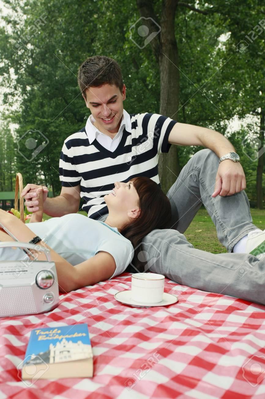 Man and woman having a picnic Stock Photo - 8149282