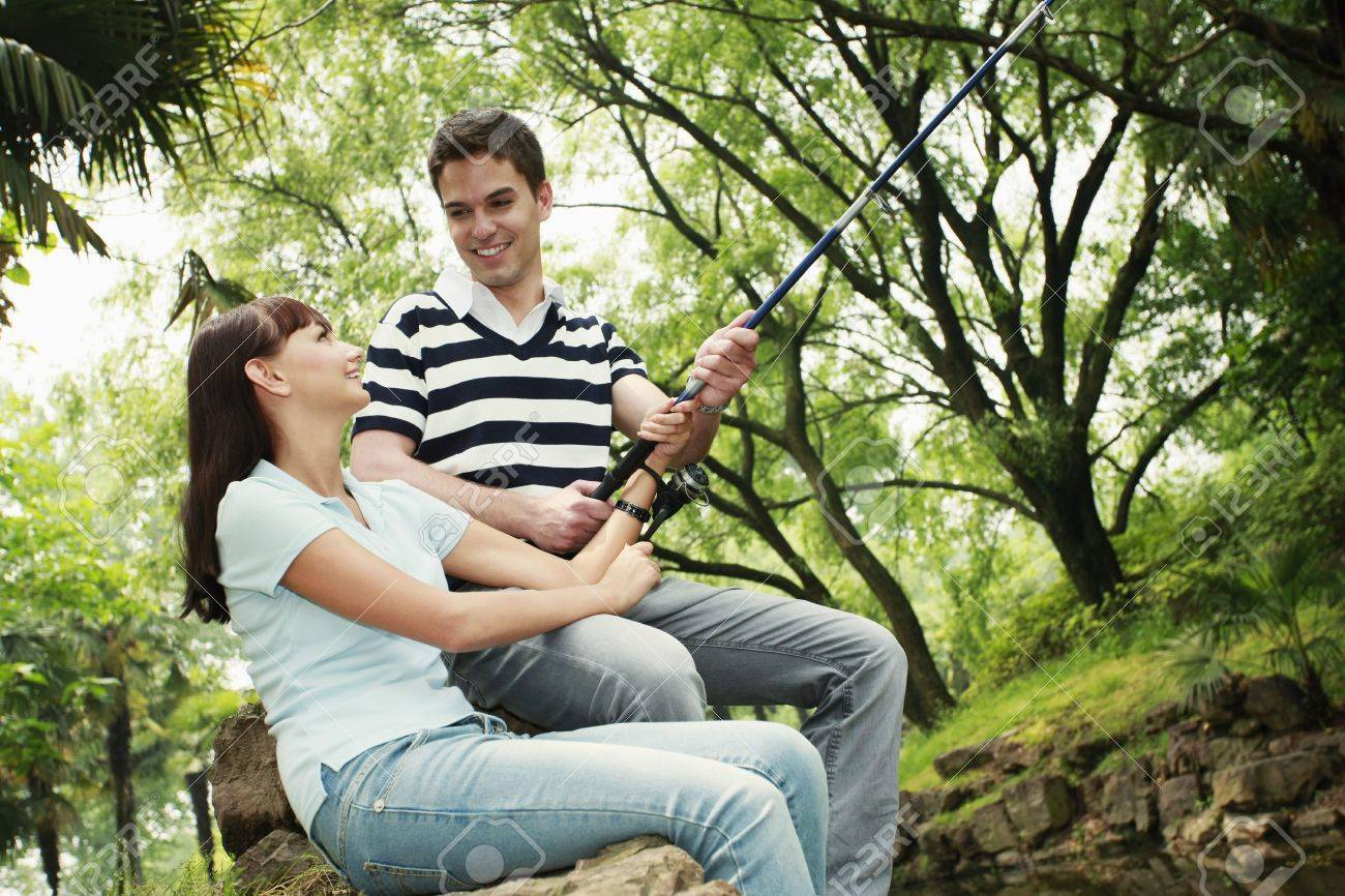 Man and woman fishing together Stock Photo - 8149402