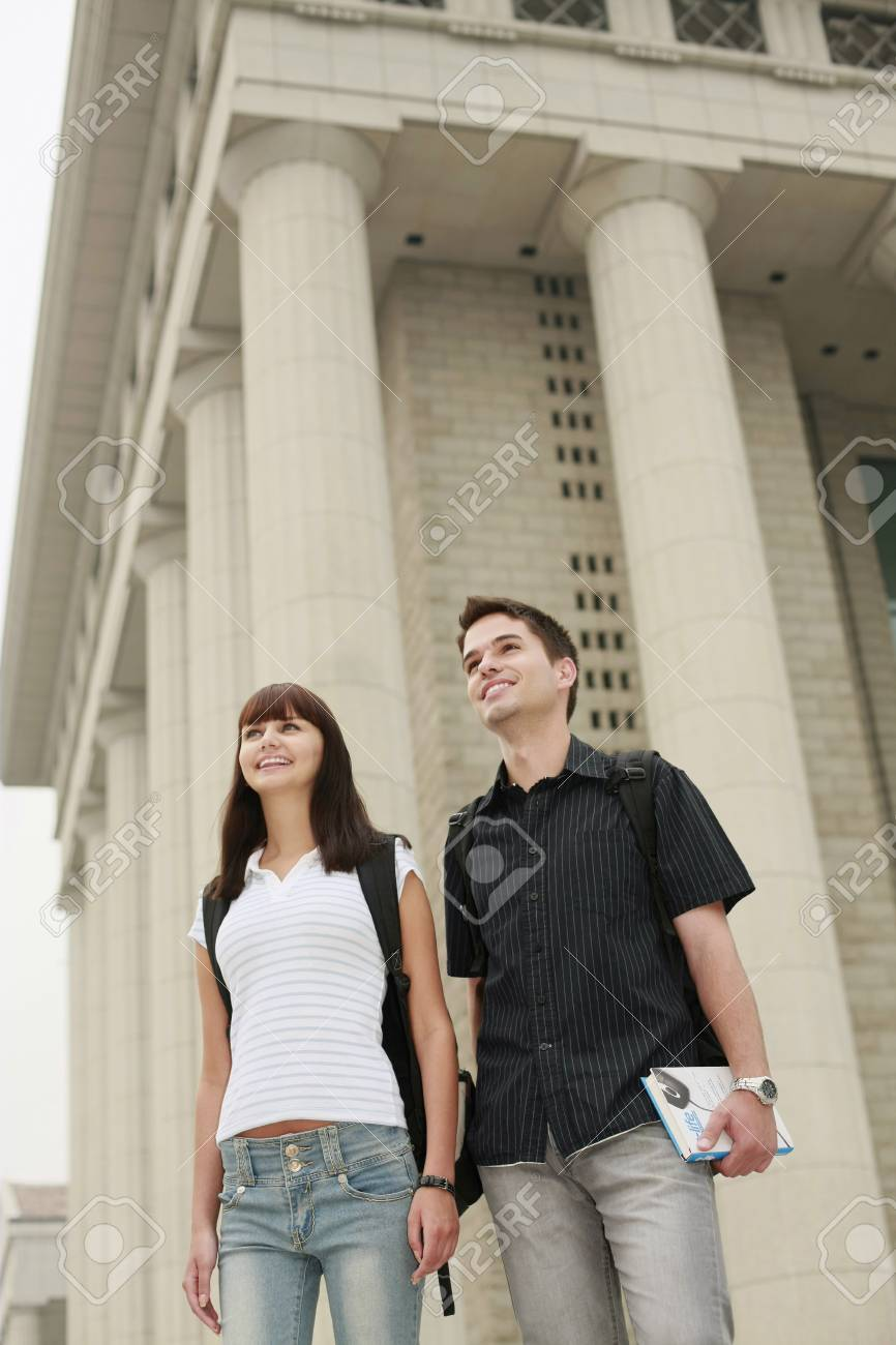 Man and woman with backpacks looking away Stock Photo - 8148897