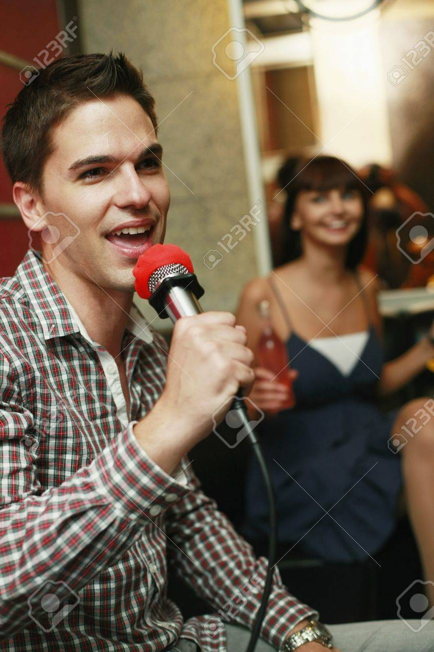 Man singing in karaoke bar Stock Photo - 8149283