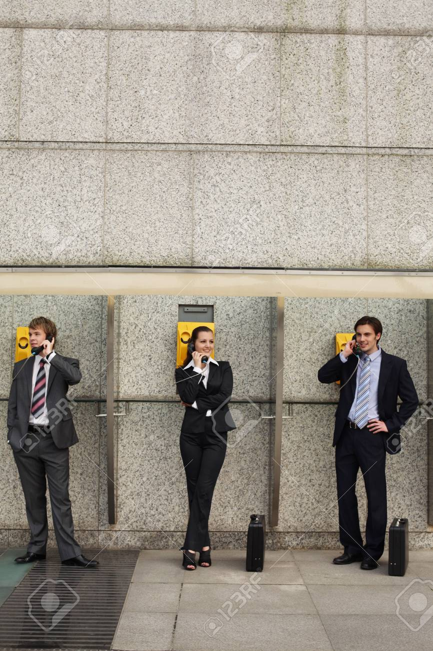 Business people using public telephones Stock Photo - 8149472