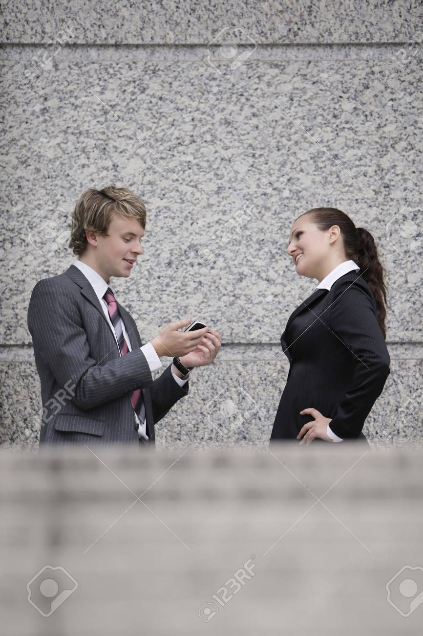 Business people talking to each other Stock Photo - 8149242