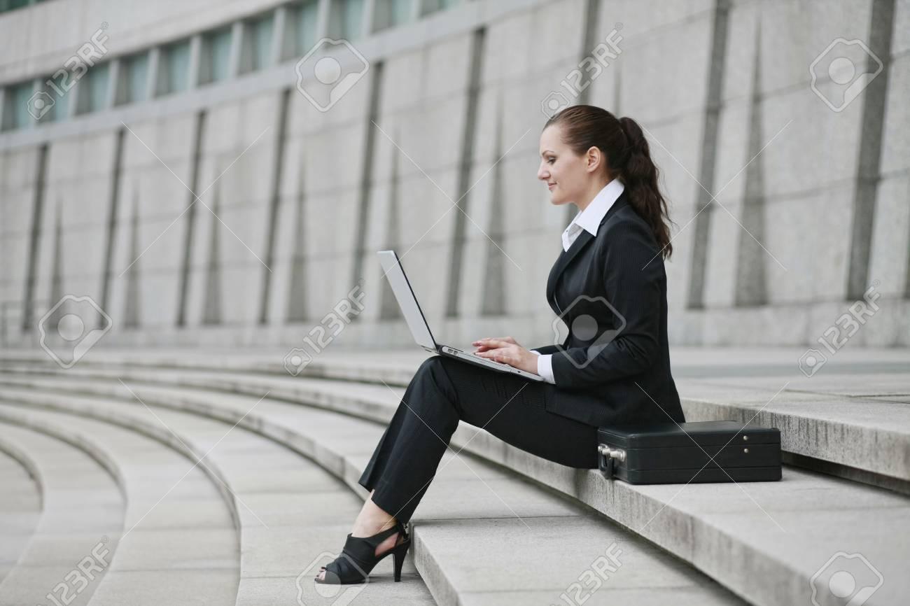 Businesswoman using laptop outdoors Stock Photo - 8148706