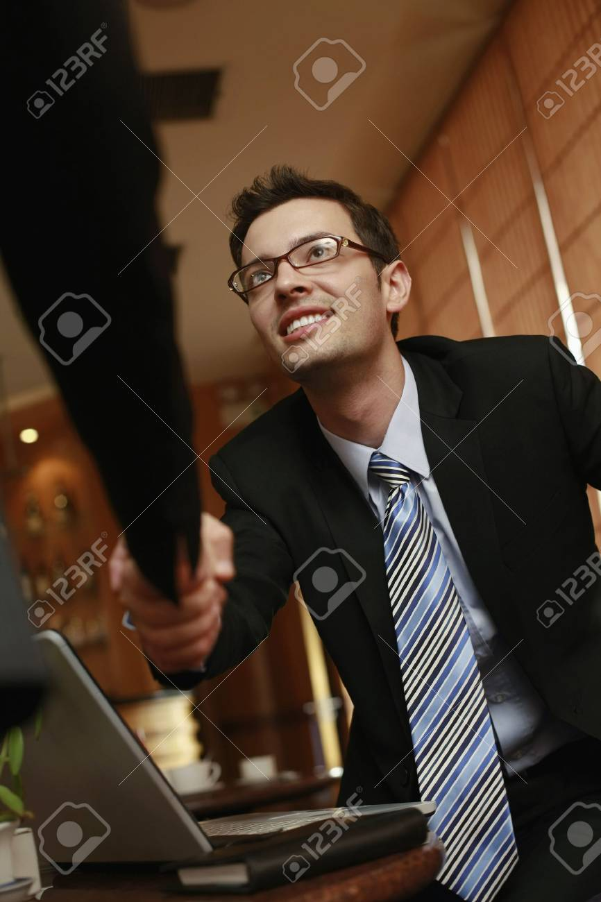 Business people shaking hands in a cafe Stock Photo - 8148646