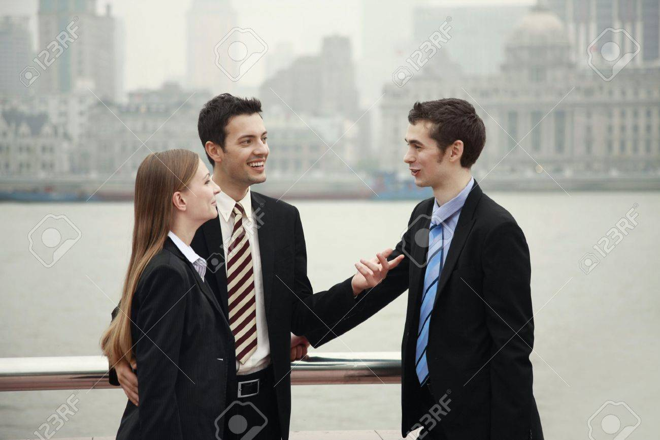 business people talking to each other outdoors stock photo picture
