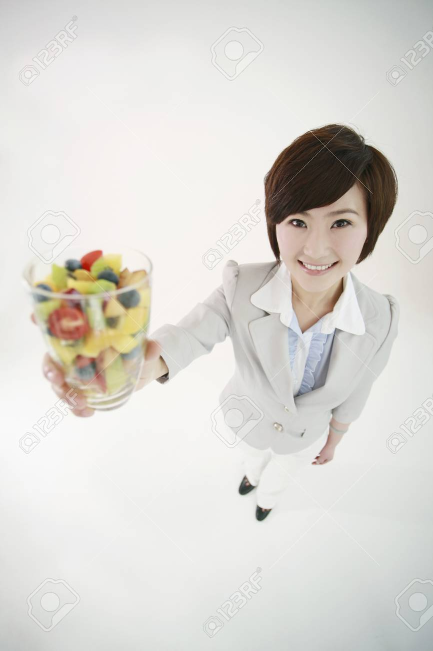 Businesswoman holding a glass of mixed fruits Stock Photo - 8259996