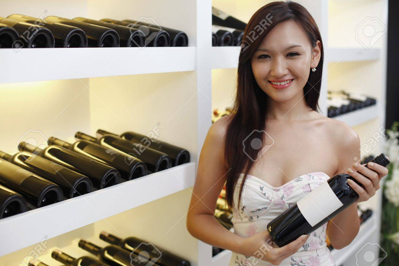 Woman holding a bottle of wine Stock Photo - 8430620