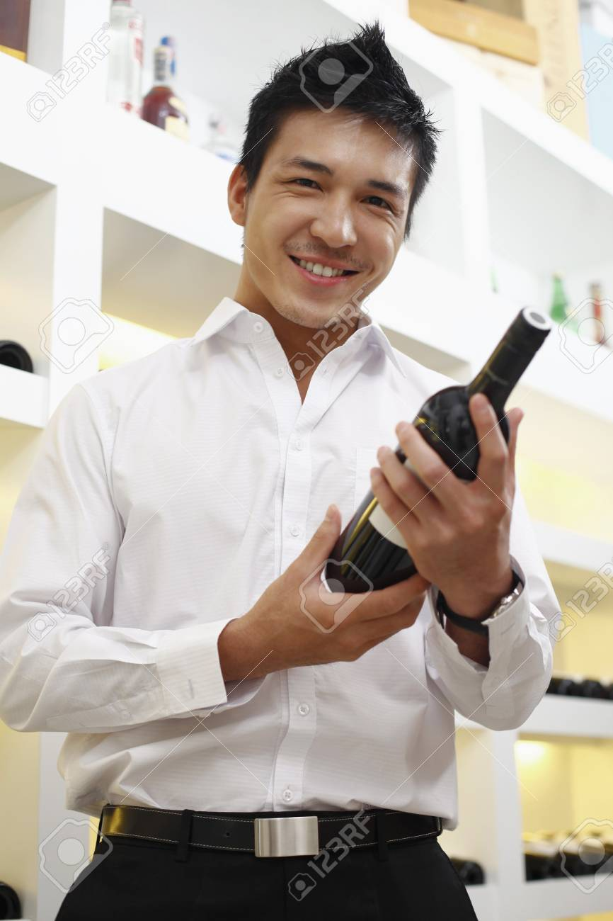 Man choosing wine Stock Photo - 8430674