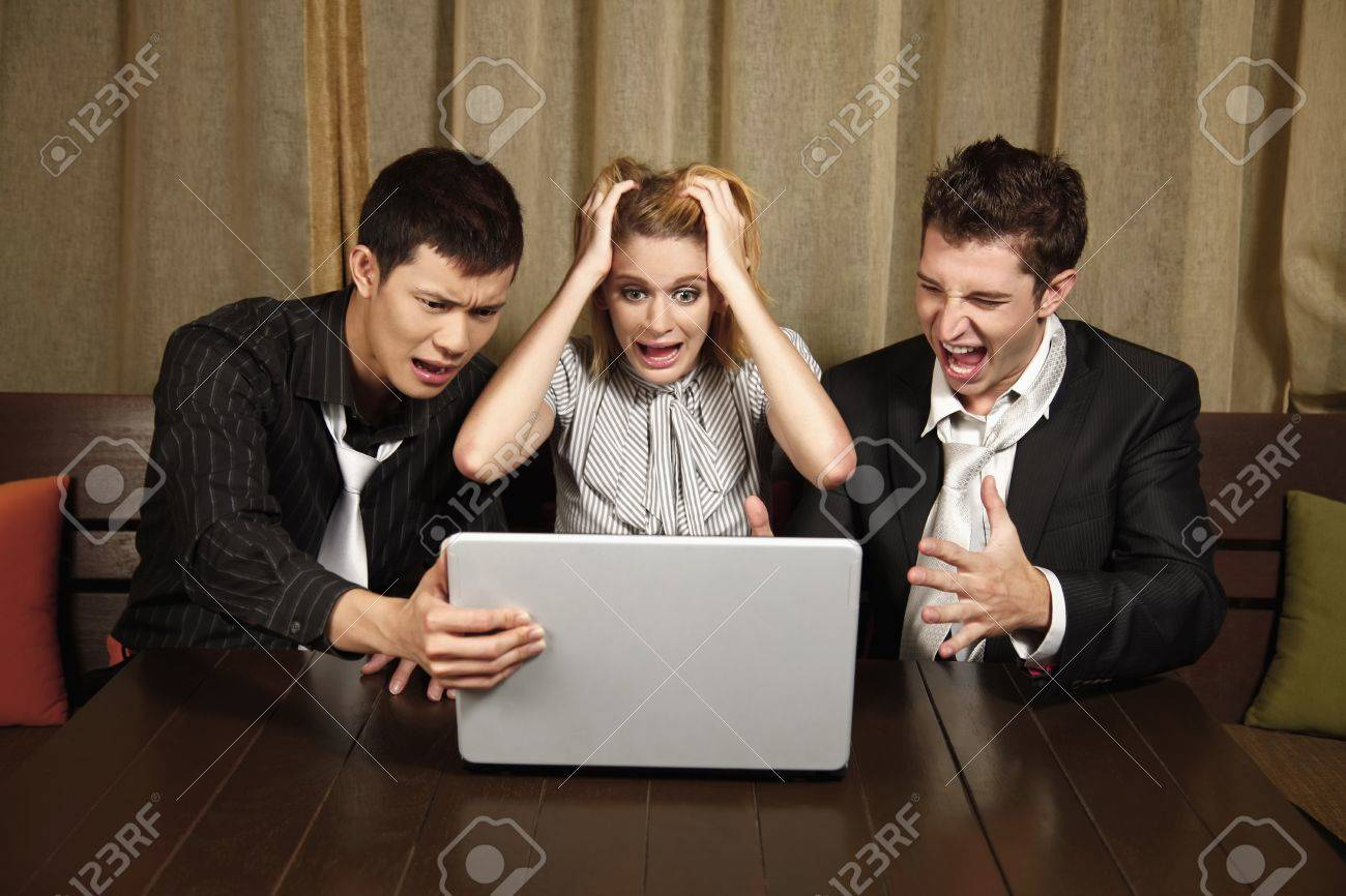 Stressed business people looking at laptop Stock Photo - 8536753